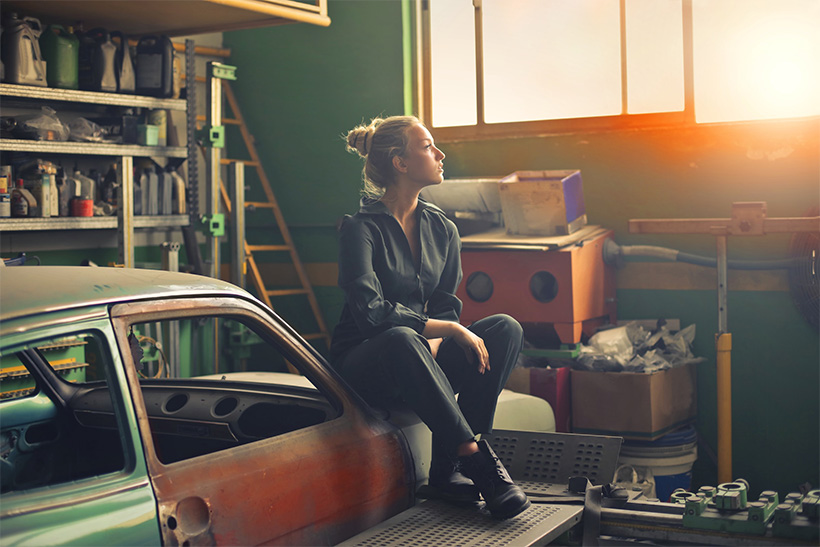 A woman sitting in a neat garage