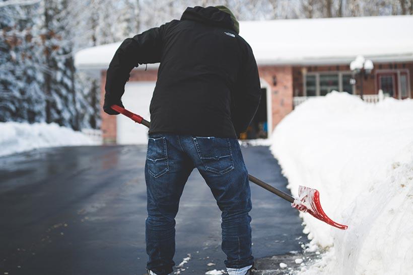 Man Shoveling The Snow